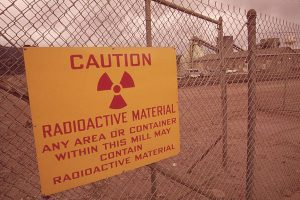 Photo: Bill Gillette, US National Archives and Records Administration Sign at shuttered uranium mill in Rifle, Colorado, warns onlookers of hazards that remain from Cold War era nuclear weapons production.